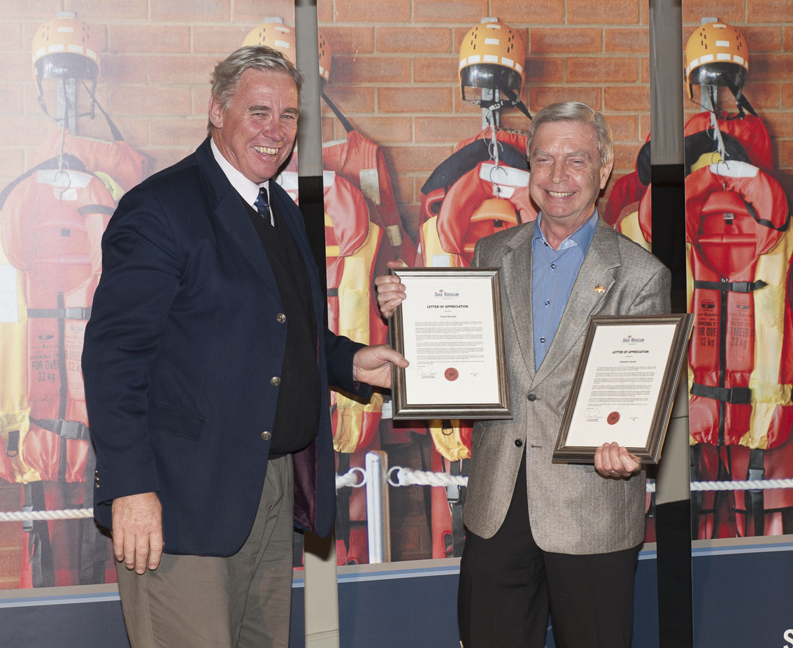 NSRI CEO Dr Cleeve Robertson presentsan award for the rescue of kite boarder Markus Wolff near Melkbosstrand by his friends Timsel Steinfels and Sebastian Deneke. (The award was accepted by Mr Klaus Heidorn, Deputy Head of Mission at the German Consulate General.)