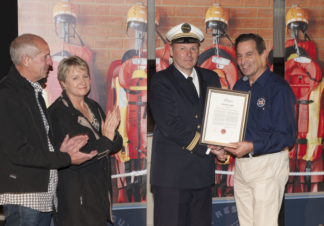 Ray and Linda Castelyn ( parents of Kyle) clap as CaptainHervé Lepage receives his award from NSRI Chairman Ronnie Stein. Picture Andrew Ingram / Sea Rescue