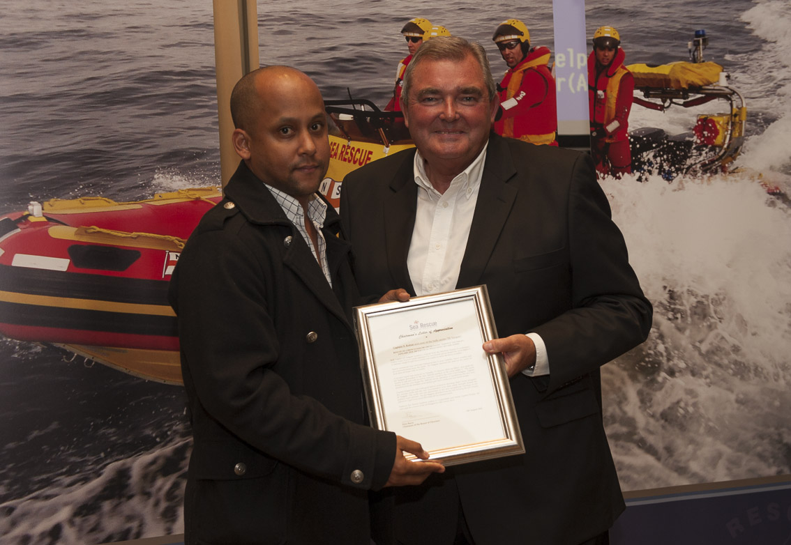 JS Yangste for the rescue of crew on yacht Idefix 2 – Presented to Nigel Dooling by Peter Bacon.