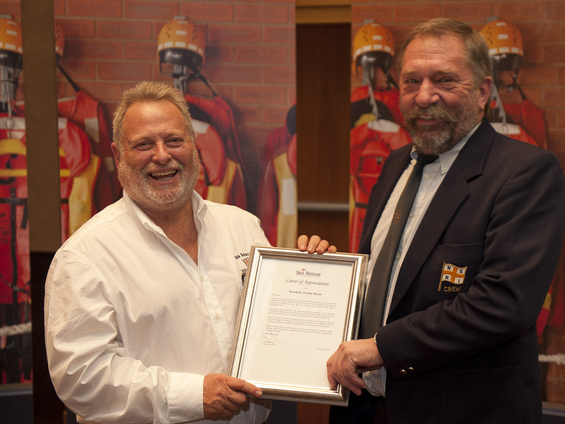 Henk Henn  receives his Letter of Appreciation.