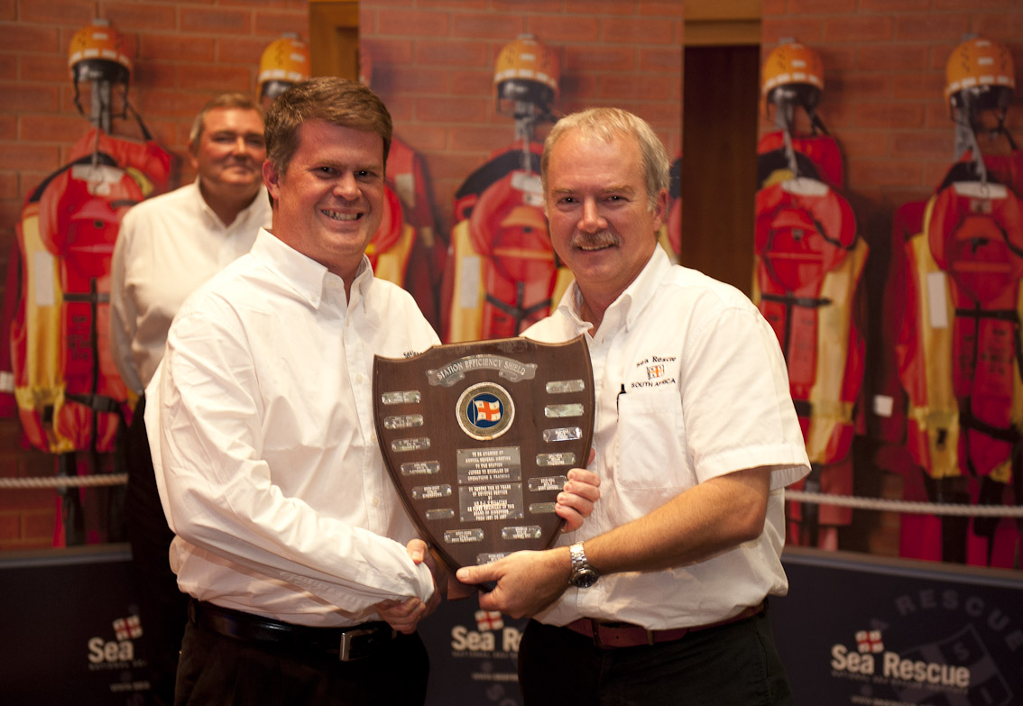 Clifford Ireland receives the Station Efficiency award from Mark Hughes.