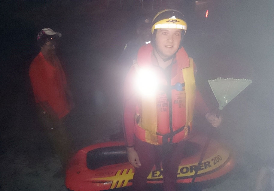 NSRI's Alex Albert with the garden rake and small boat behind him. Picture NSRI.