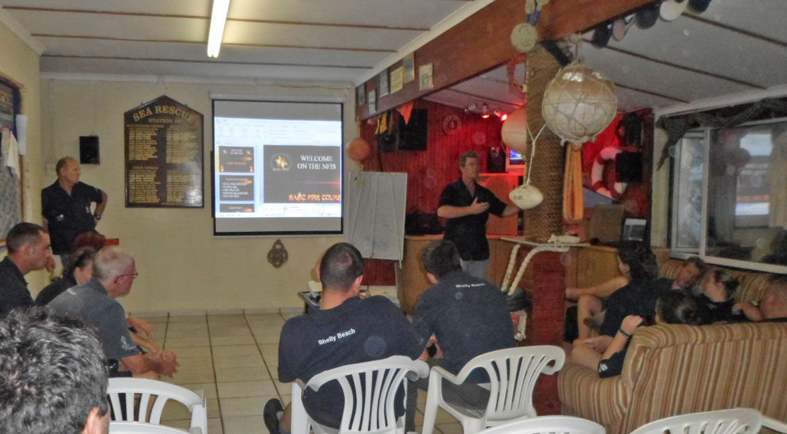 Cal King from National Fire Investigation Services explaining fire fighting theory.