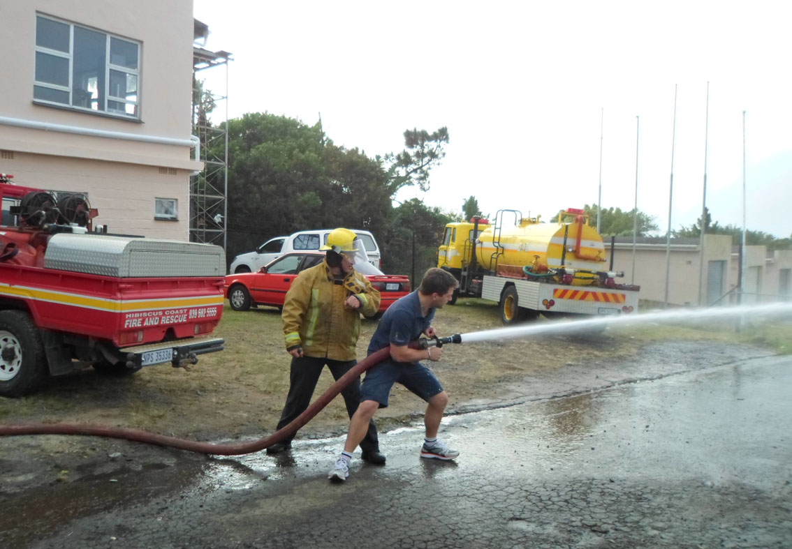 Lourens Kruger in action with a high pressure hose.