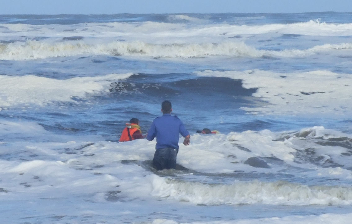 NSRI rescue swimmers Andre Barnard (25) and Josh Henn (17) save Paul van Rensburg, 35, from Pinelands who was caught in a rip current off Fisherhaven lagoon. It is without a doubt that Paul van Rensburg's life-jacket saved him from drowning.Picture Deon Langenhoven / NSRI.