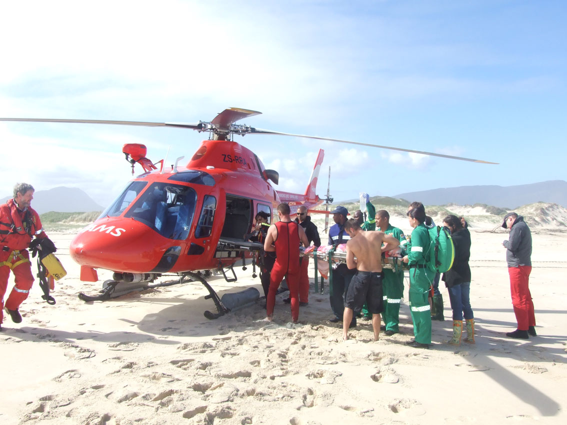 Paul van Rensburg is lifted into the AMS helicopter.