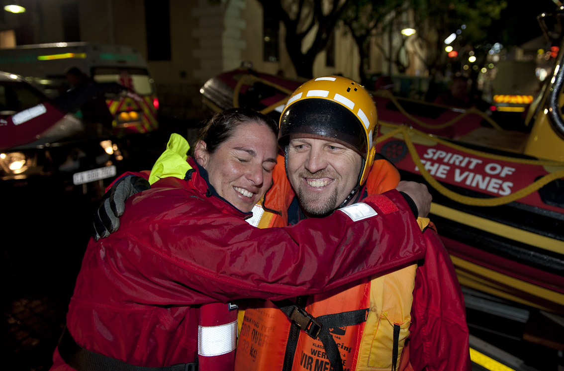 NSRI volunteer Kim Germishuys hugs Coxswain Kobus Meyer after the dramatic rescue. 12 Crew were rescued by NSRI volunters off the Hout Bay fishing boat Claremont which went aground on Robben Island on Monday night 12 August 2013. Picture Andrew Ingram / NSRI