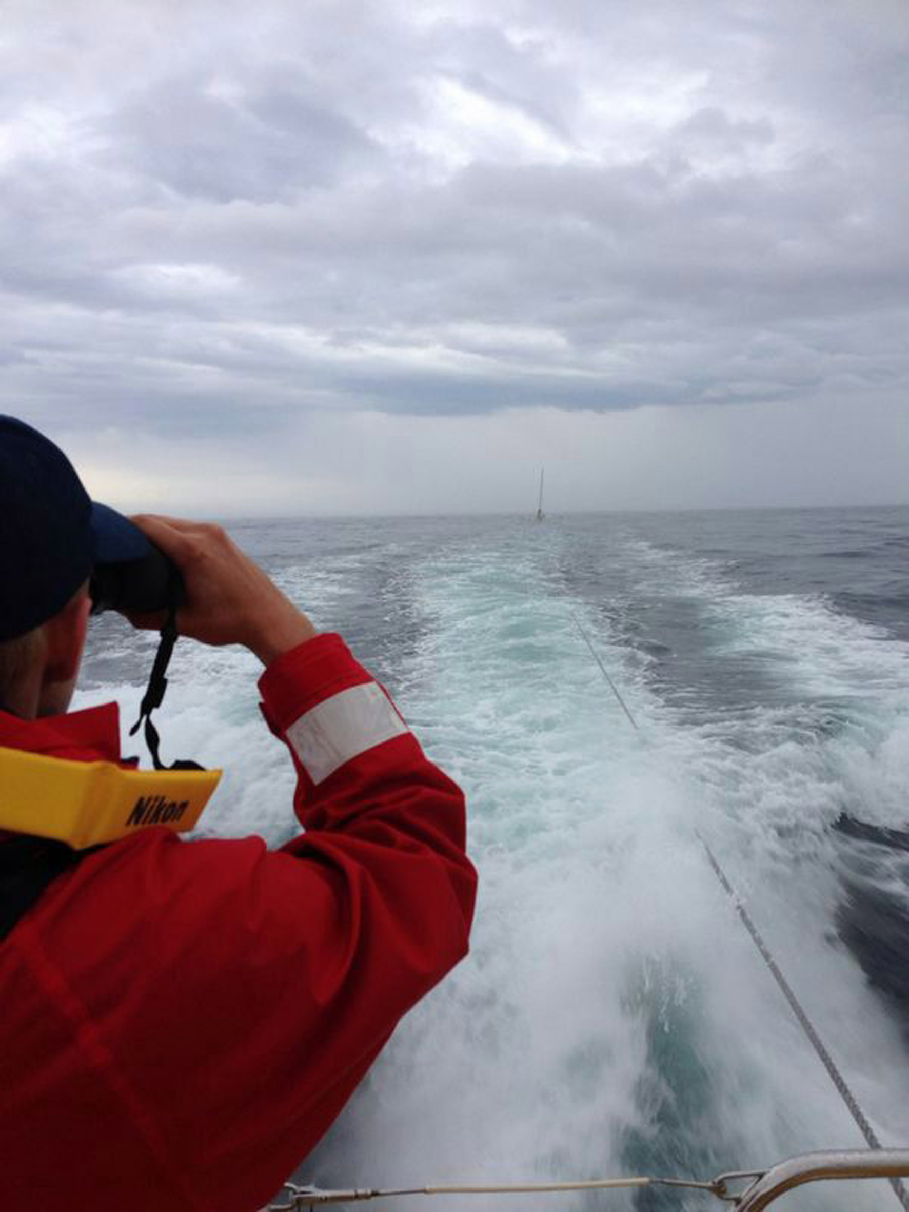 The Spirit of Vodacom tows the Cape to Rio yacht Black Cat back to Cape Town. Picture Brad Seaton-Smith / NSRI.