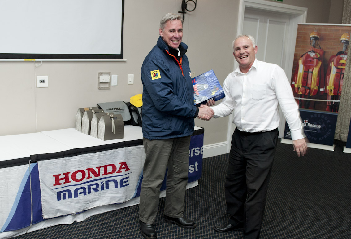 Tim Bellairs receives his raffle prize.