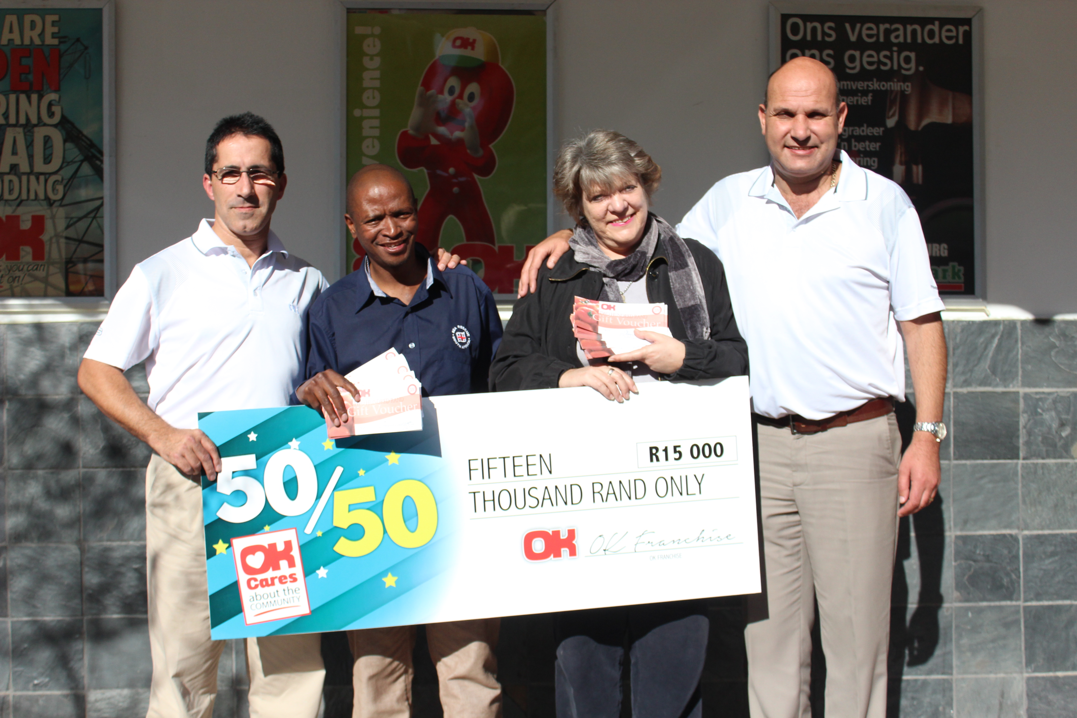 Jose Dos Santos of OK; Richard Tsholoba (NSRI), Lizette Geldenhuys ( our winner) and Jack Voges (OK) at at OK MiniMark in Denneburg Paarl. Picture Maryke Swart / Paarlpost.
