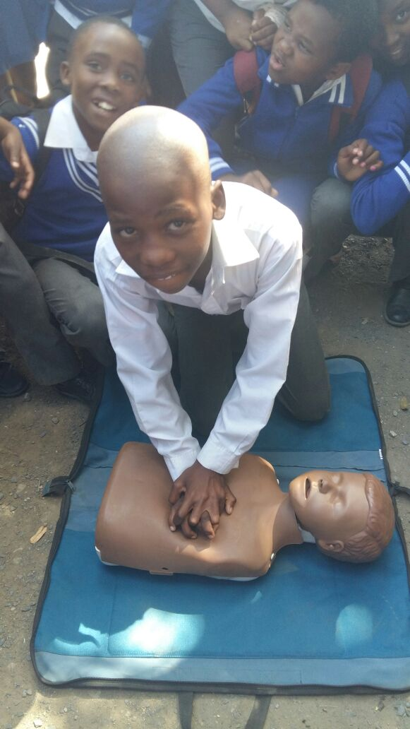 Child doing CPR - Onele Mathlumba a grade 6 learner from the Roman Catholic JSS school in Port St Johns learns Hands On CPR during a WaterWise lesson on Monday.