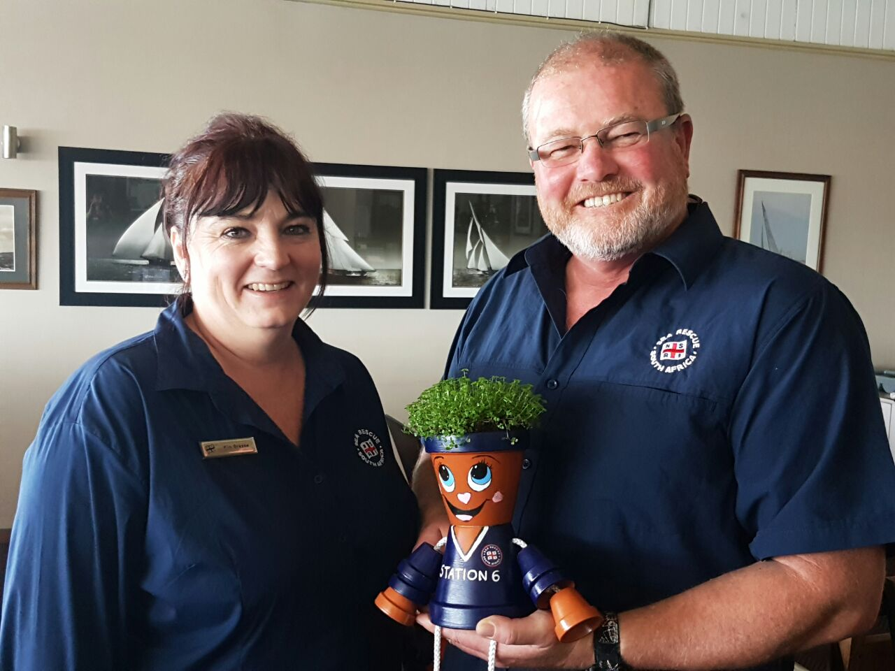 Kim Gresse presenting Station 6 with their very first potplant for their newly renovated base as per their wishlist.