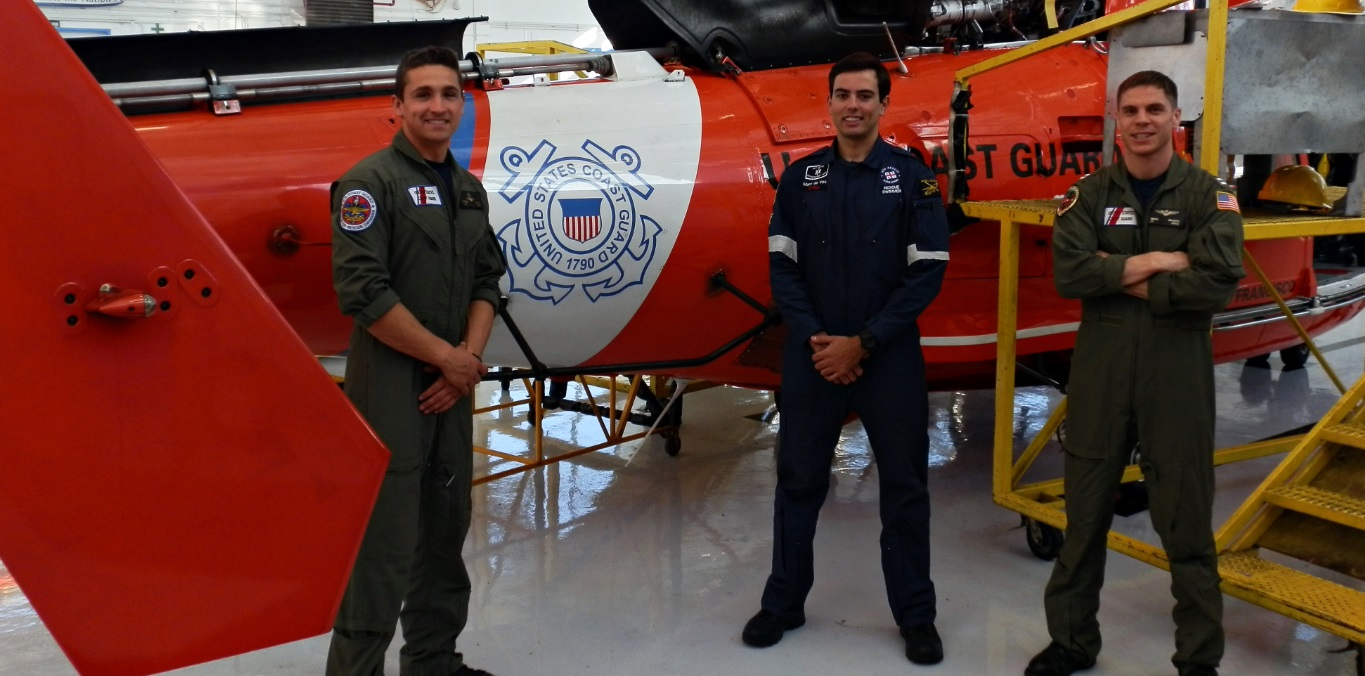 Petty Officer Ernie Child, Marc de Vos  ad Lt. Mark Sajovic in front of a sea rescue MH-65 Dolphin
