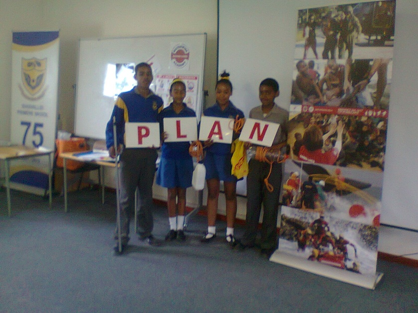 Seen here in this picture are a few learners of Idasvallei Primary School, displaying the PLAN.