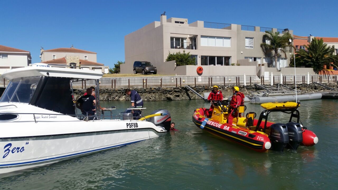 NSRI Gordons Bay sea rescue craft Spirit of Surfski at the casualty boat Zero at Harbour Island.