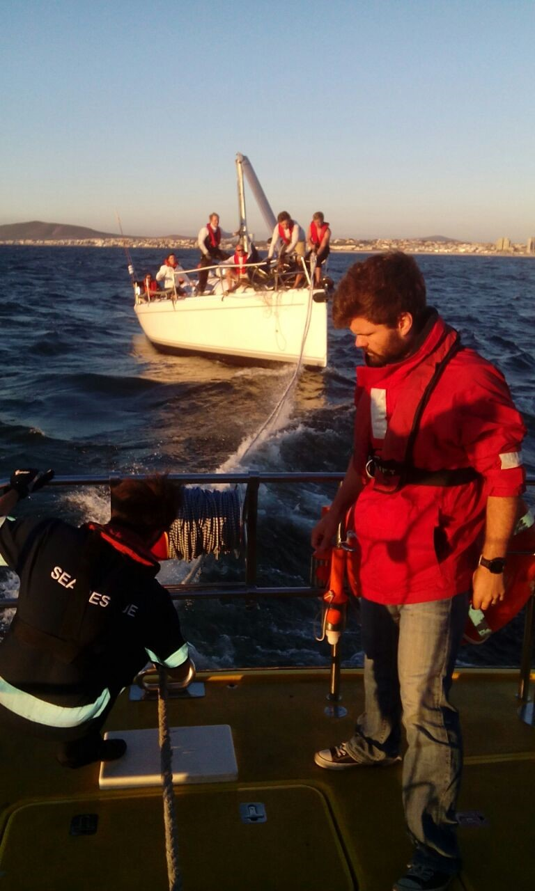 By NSRI Table Bay. NSRI Table Bay rigging a tow-line to the dismasted yacht Cape Dancer.