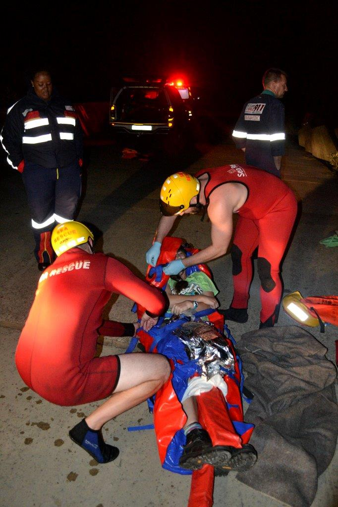 The casualty being assessed before transportation.