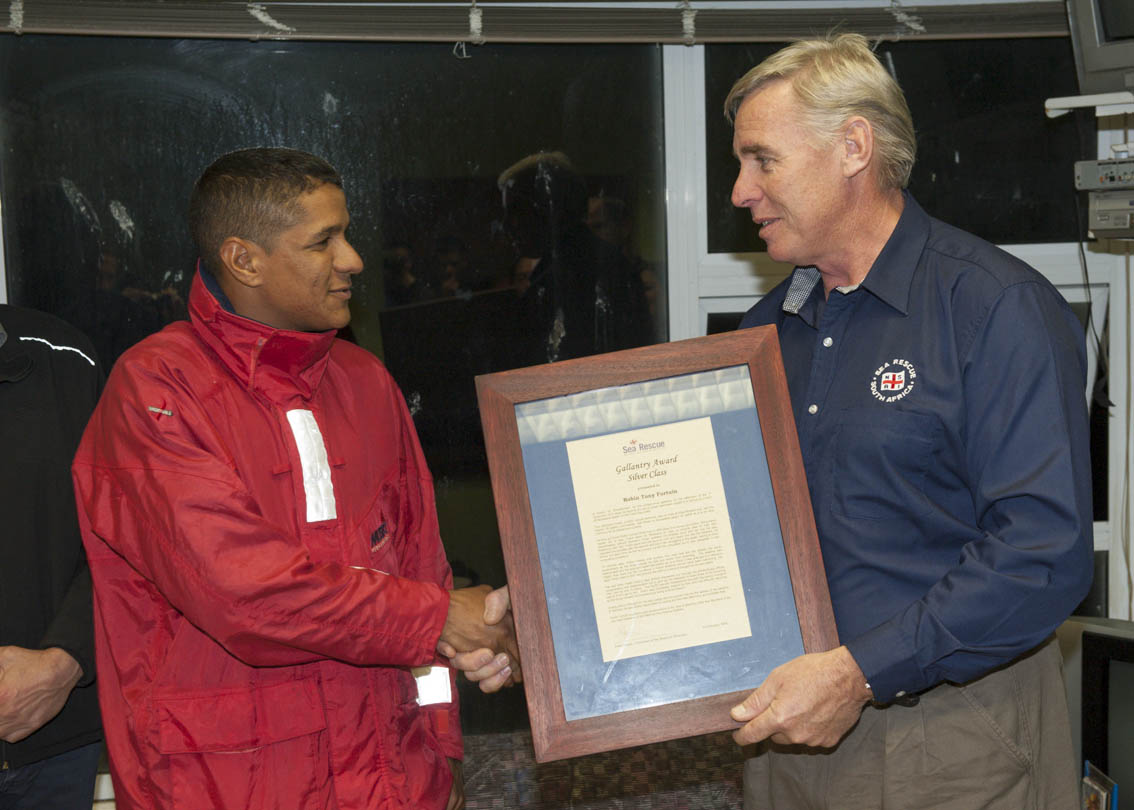 Robin is given his Gallantry award by NSRI CEO Dr Cleeve Robertson.