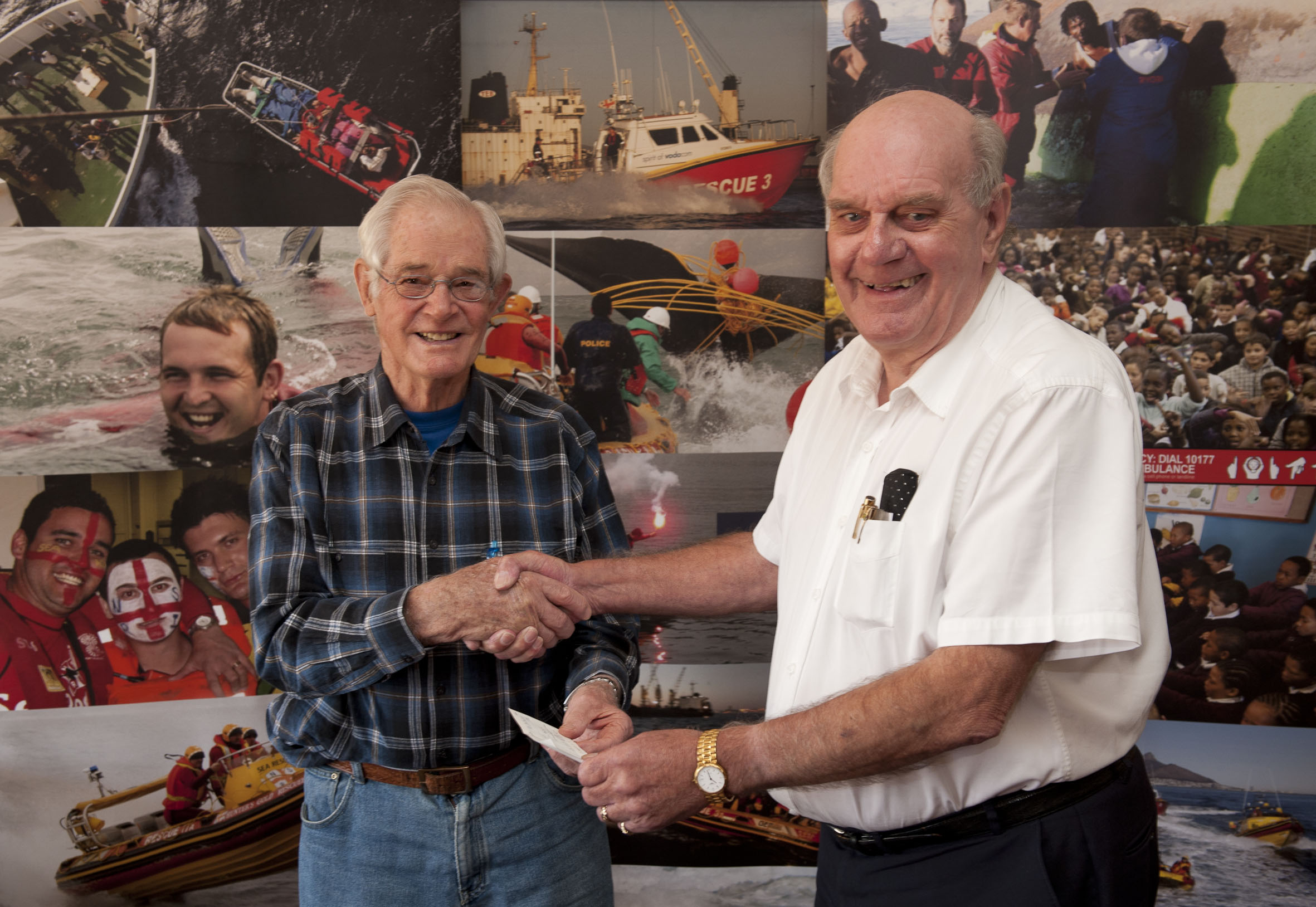 Chris Rainier-Pope hands the cheque to Bill Wells.