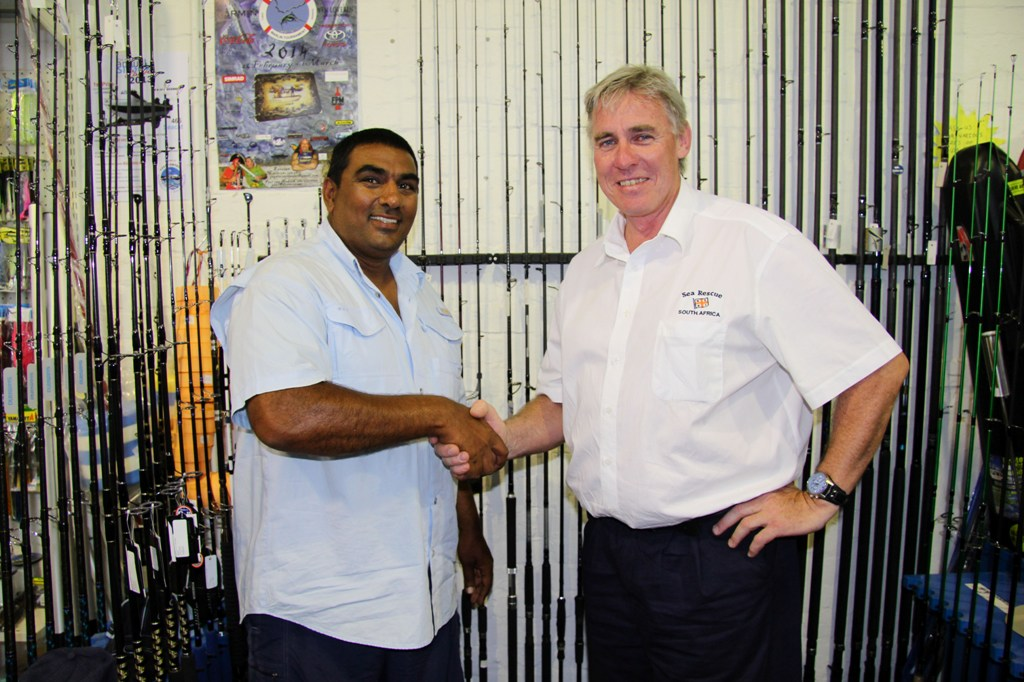 Ismael Sonday handed the cheque to Cleeve Robertson of the NSRI.