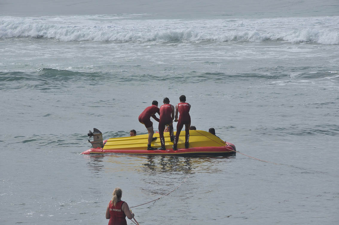 Shelly Beach crew right the RIB.