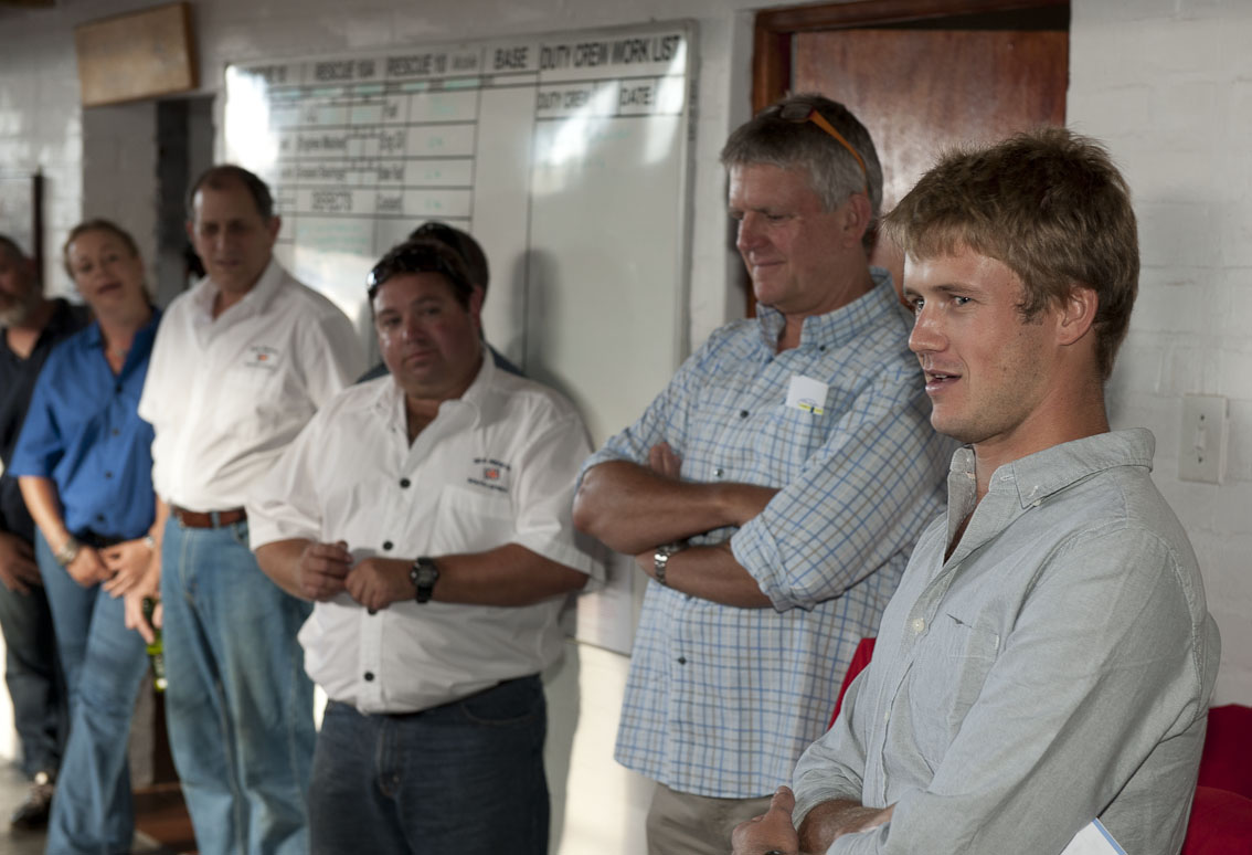NSRI crew listen as David Black ( right )  thank them for rescuing him.Standing next to David is his father Mert.