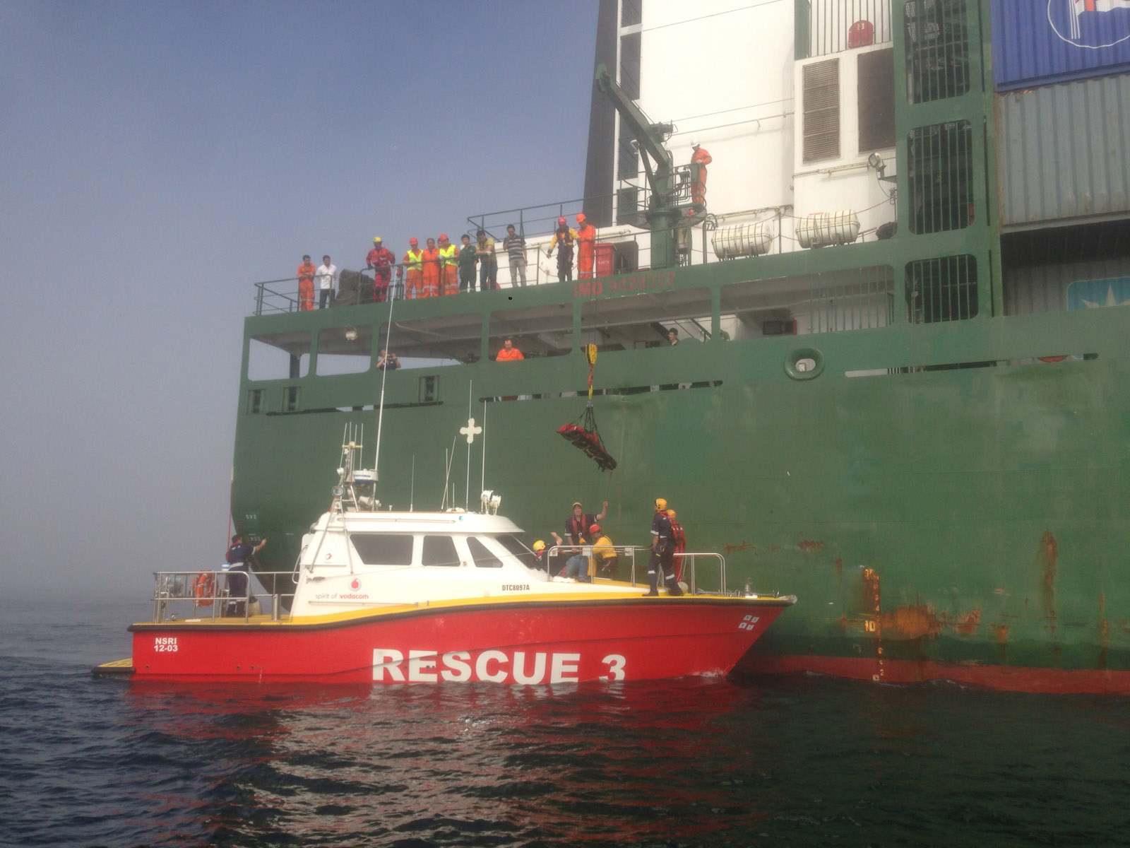 The patient is lowered onto the Spirit of Vodacom. Picture PJ Rabie/NSRI.