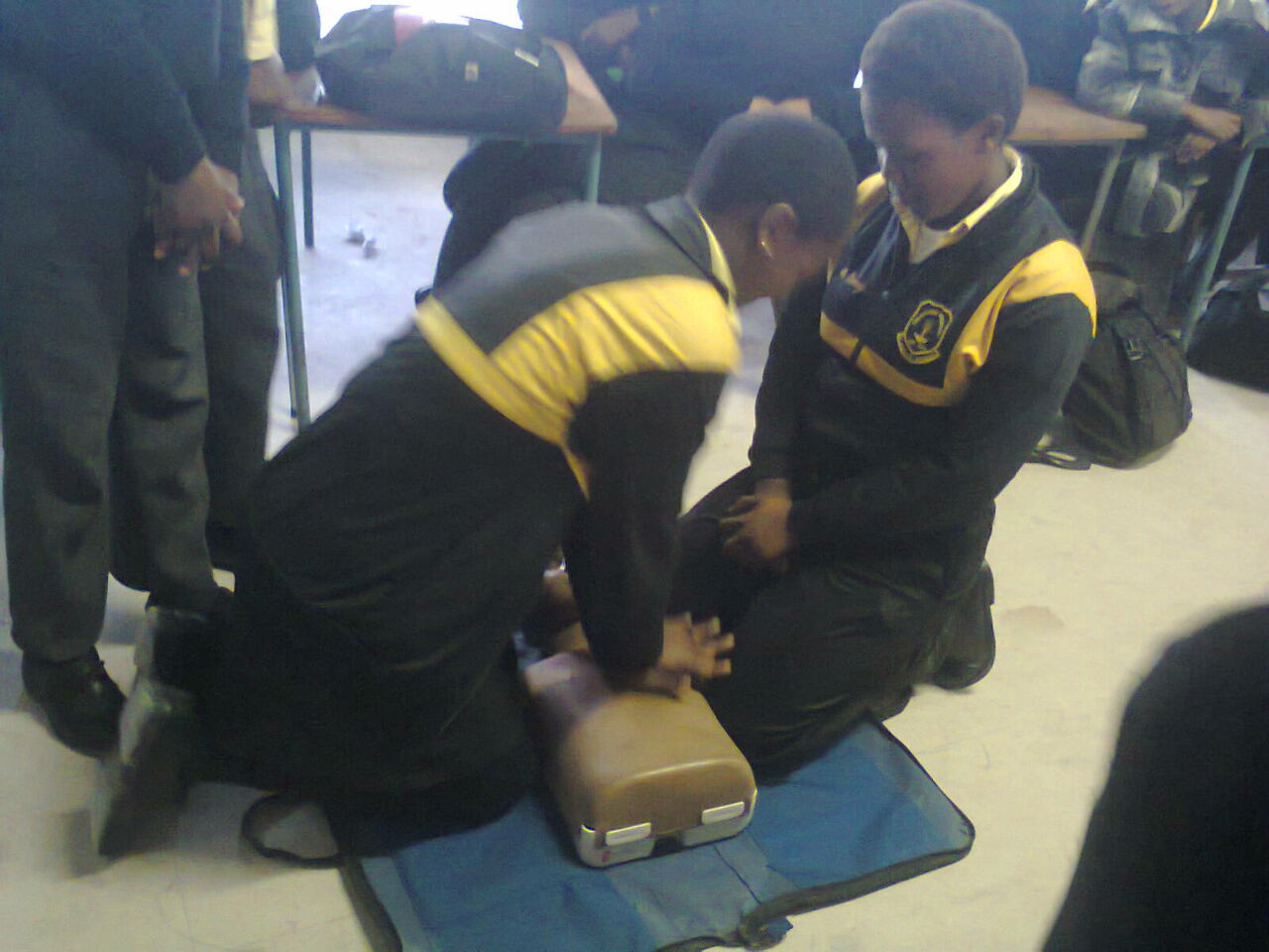 Sima,15, and Nosie,16, practice Hands On CPR.