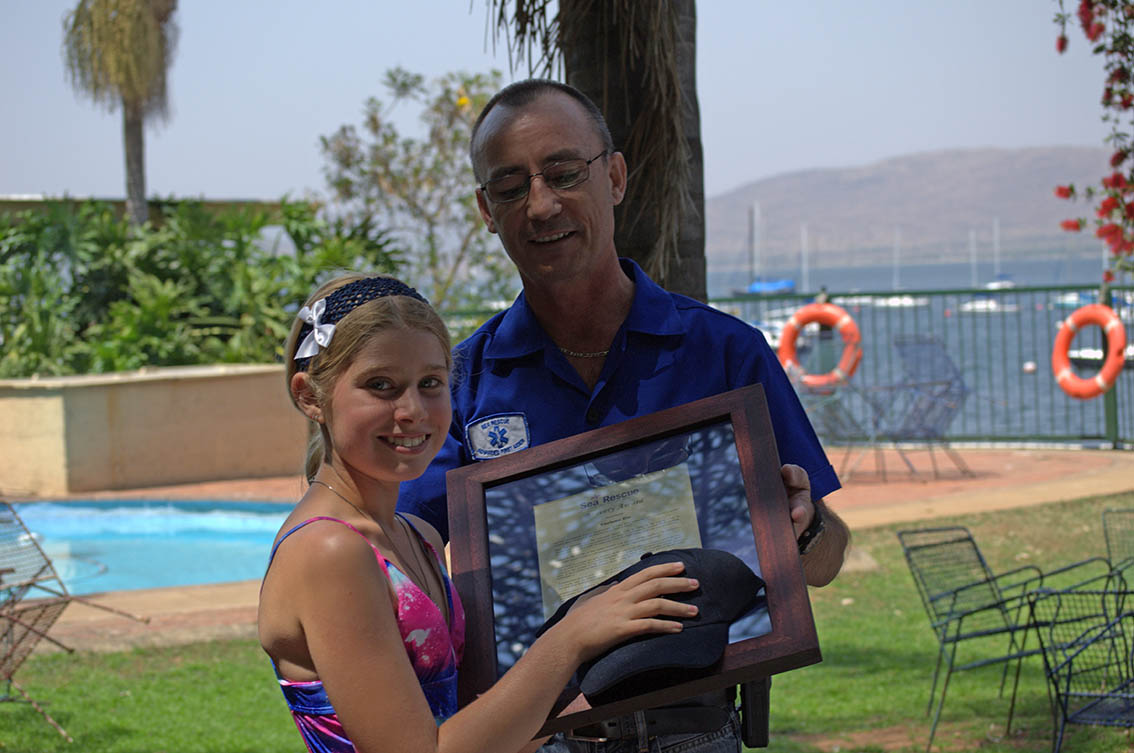 Yoleen Els receives her award from deputy station commander Michael Saunders.