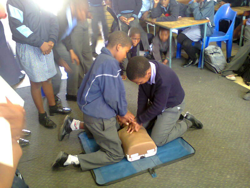 Bonga and Amamge from Mzamomhle Primary School are practising CPR.