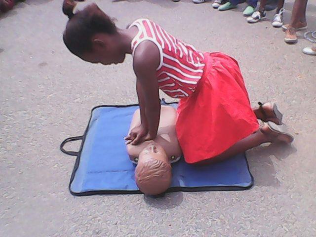 Mahle(13) practising CPR at Khwezilesizwe primary in Khayelitsha.