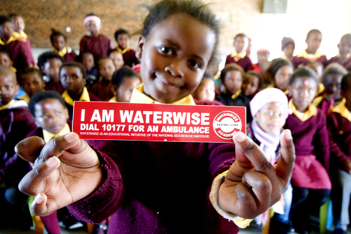 Aphelele Ndamane a Gr R pupil at Tyholora Primary is WaterWise.