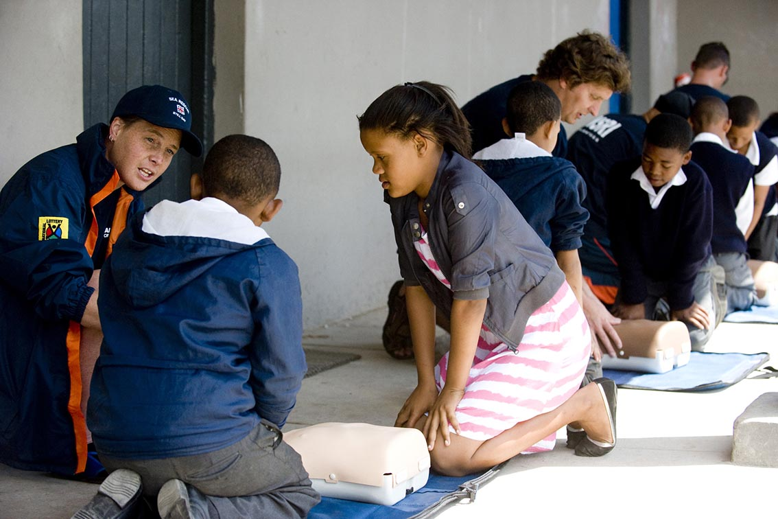 Crew from Station 31 helping learners at Melkhoutfontein with bystander CPR.
