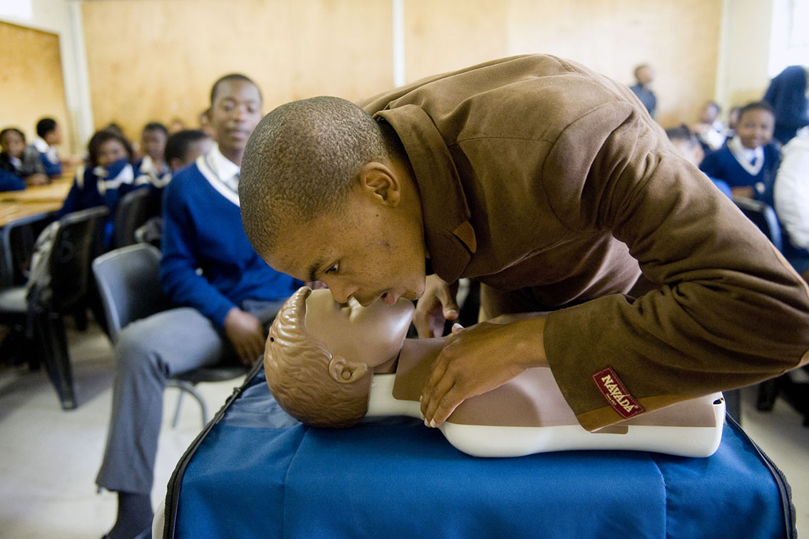 A grade 11 learner from Thembalethu Sec, saying HELLO, before starting CPR
