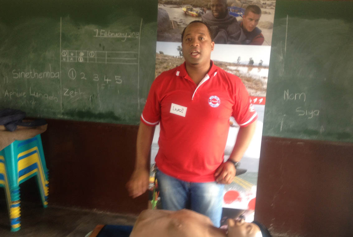 Lwazi teaches the children about bystander CPR.