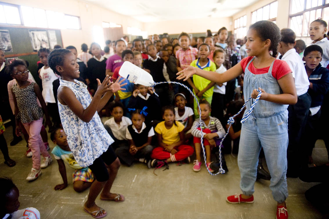 Nikesha Afrika 9 throwing a rope to Zandile Dolophi 9, demonstrating how to save a friend