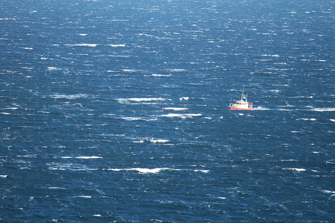 The rescue boat approaches the double surfski. Piture by Gary van Rooyen