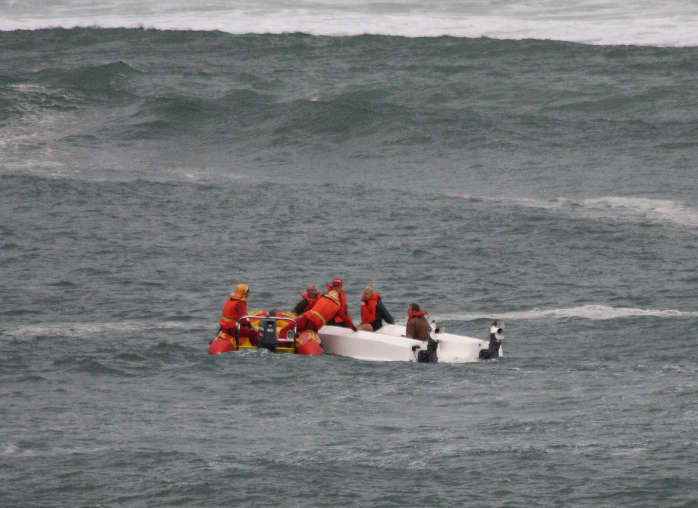 A capsized boat is helped by NSRI crew at Witsand. Picture by Peter Adriaens.