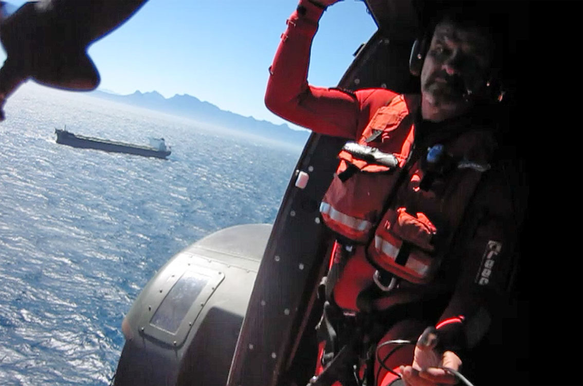 NSRI ASR crewman Andre Beuster in the SAAF Oryx as it approached the vessel.