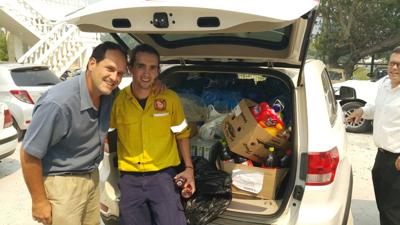 Gordons Bay station commander Anton Prinsloo and WoF Jacques Joubert with supplies for the fire fighters.