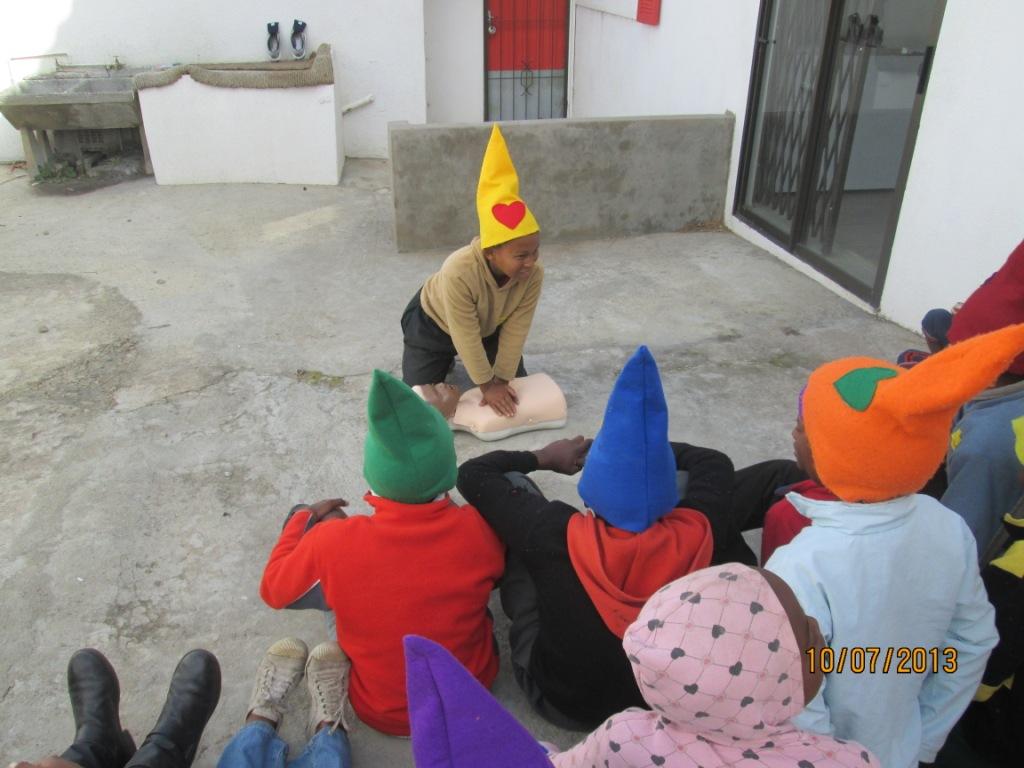 The children practice CPR.