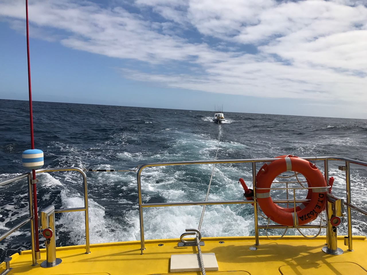 NSRI East London - Spirit of Lotto takes up the tow of Captain Morgan