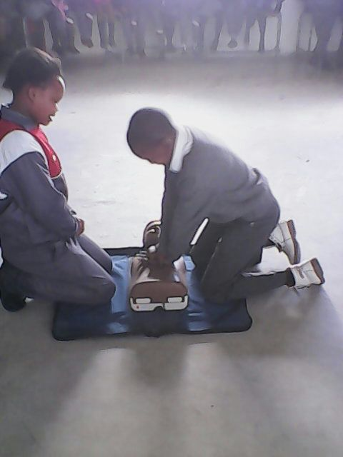 Lindo ,15, and Sima,16, practicing cpr at Linge primary.