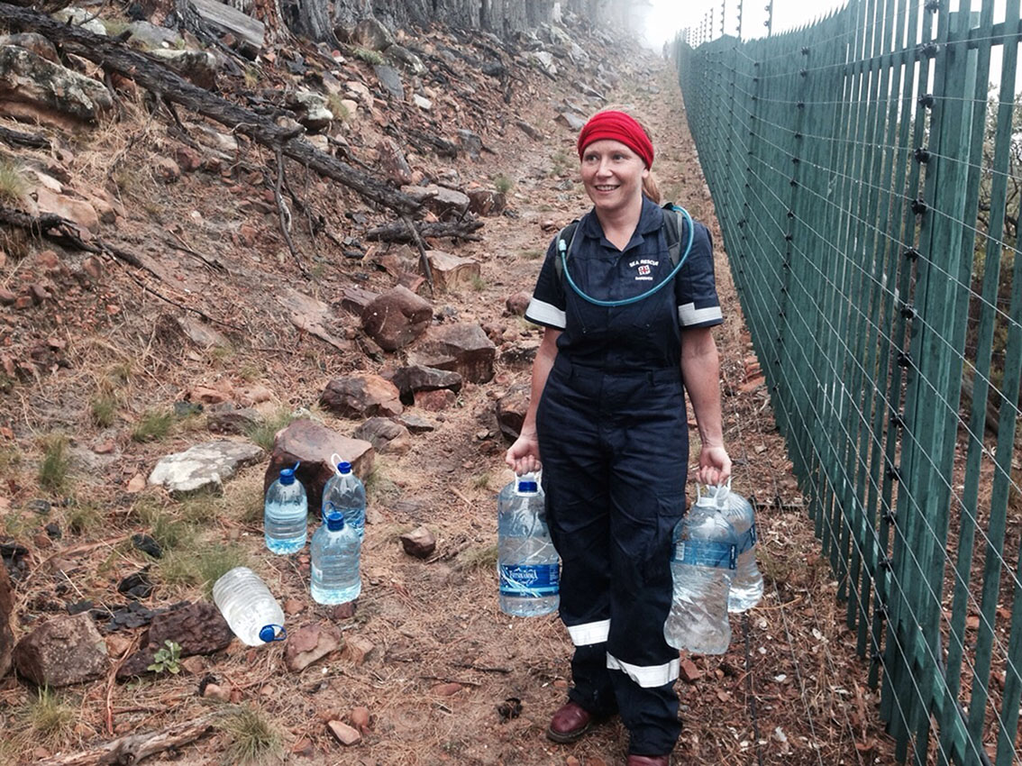 Coralie McDonald taking water to firefighters on the line.
