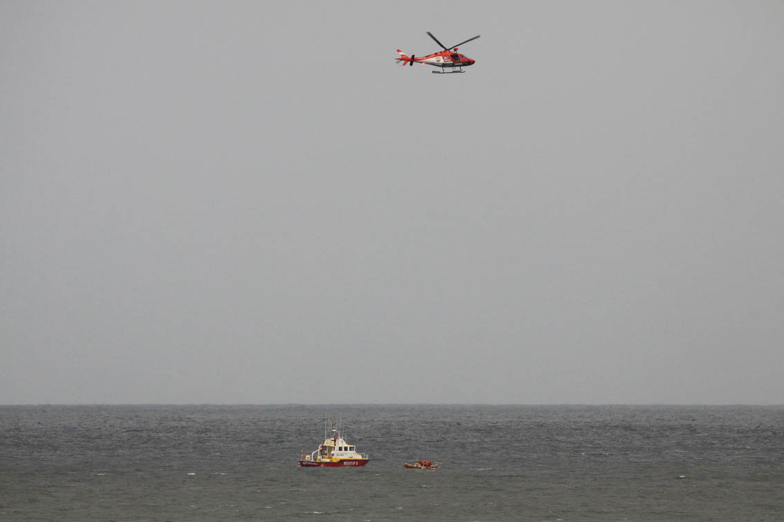 The AMS helicopter flies over the Gordons Bay rescue boat Jack Riley and Hermanus rescue boat Hunters Gold Rescuer after the two men were found. Picture by Richard Starke