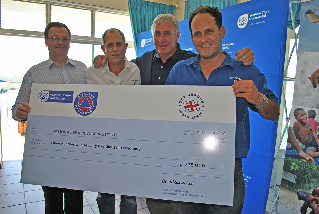Minister Anton Bredell, Dave Roberts, Cleeve Robertson and Anton Prinsloo with the cheque.