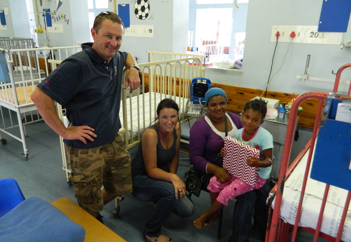 Spencer Oldham and Laura Piggott with a patient and her Mom in Victoria.