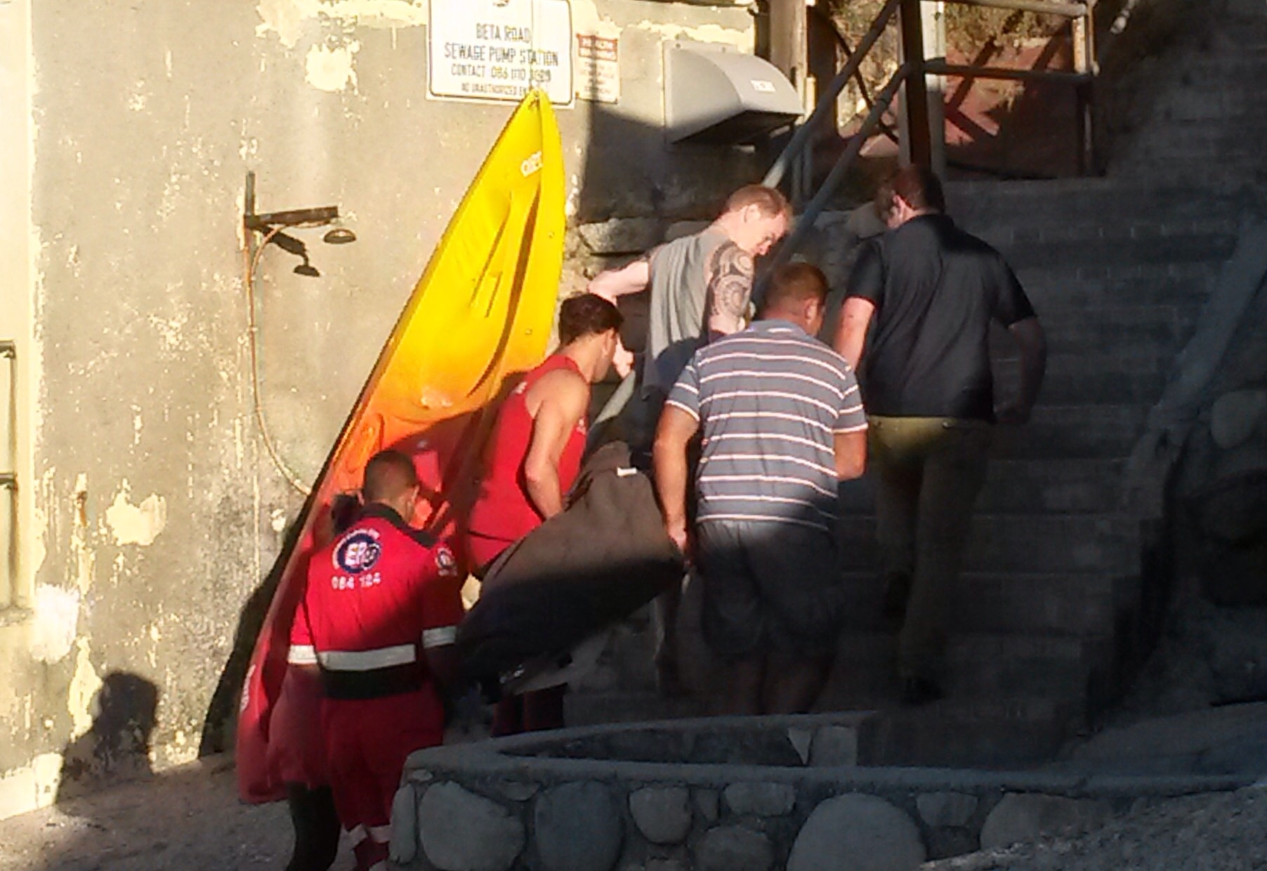 Shane Keenan is carried from the rescue base to an ambulance.