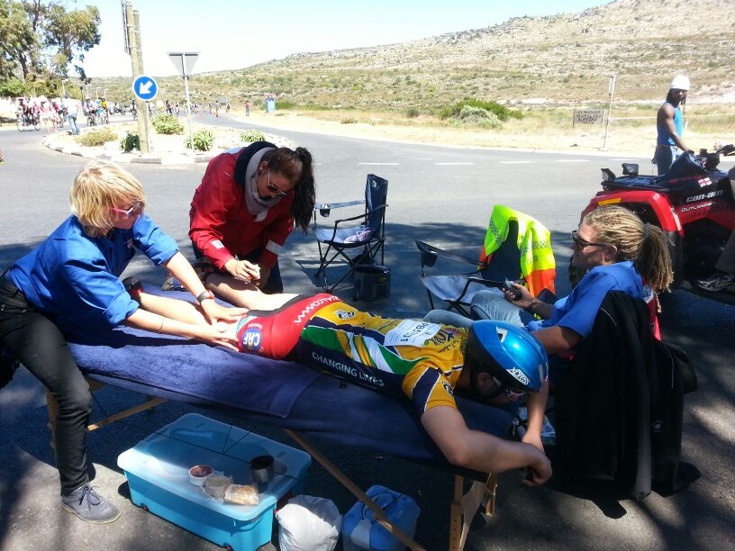 Kommetjie NSRI volunteers help a rider who was cramping. Picture Tom Coetzee.