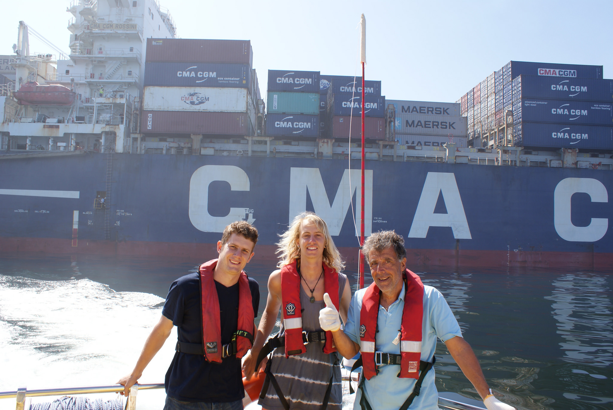 Jean Sitruk, 65, from Lyon, France and Kyle Castelyn, 20, from Strand, Cape Town and NSRI Crewman Roelf Daling aboard Spirit of Vodacom after being taken off the cargo vessel CMA CGM Rossini. Picture: Paula Leech/NSRI